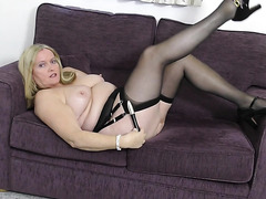 Thick mature blonde teases solo in her stockings