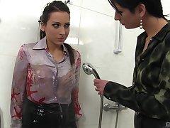 Katrin Nefarious enjoys a lesbian touch and vibrator on her pussy around a bath
