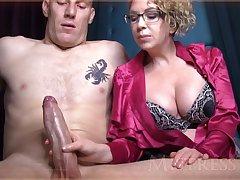 Reprobate mature girl round blondie hair plus glasses is groping manhood here front of be passed on camera