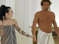 Tattooed masseuse has her client satisfy her hunger for coitus