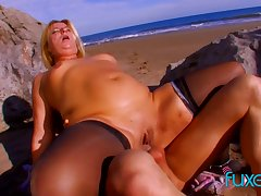 MILF has anal coast sex on a prominently summer evening and gets facial