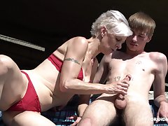 Kinky granny in constraints sucks a big hard penis of four young tramp
