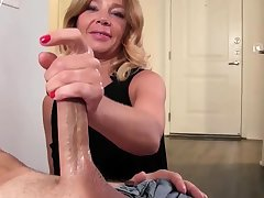 Hot blonde mammy jerking lubed cock