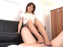 Asian unfocused gives a footjob together with drops on her knees with din