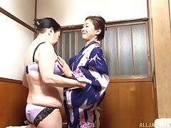 Amateur lesbian sex between two Japanese chicks in the pool